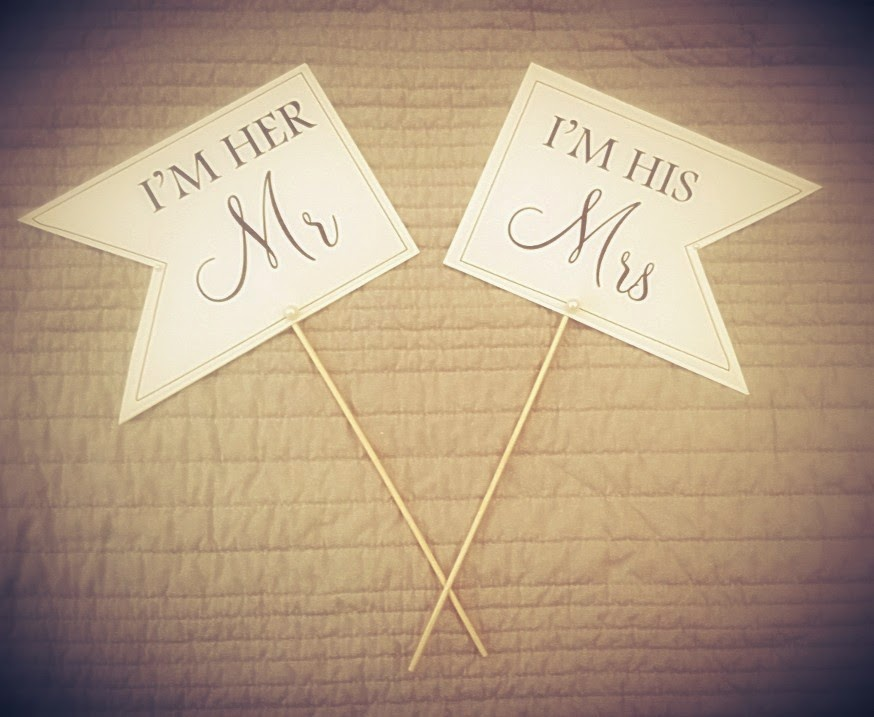 Mr & Mrs hand held signs