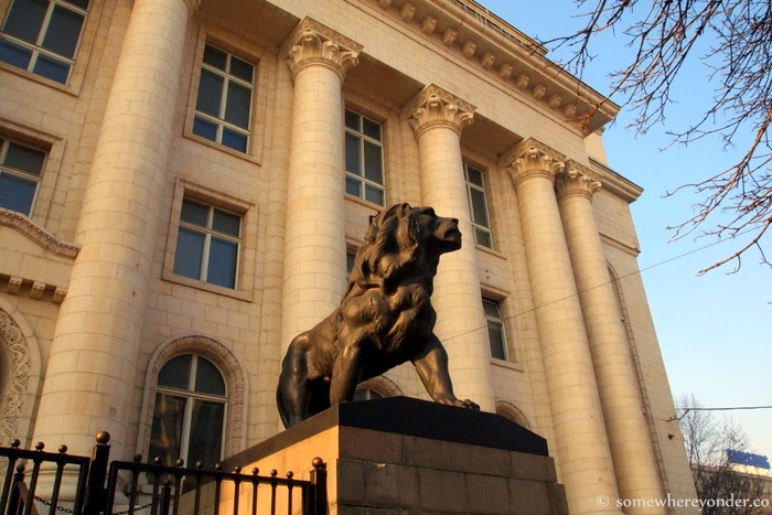 a lion guards the Court House in the afternoon sun - Sofia, Bulgaria