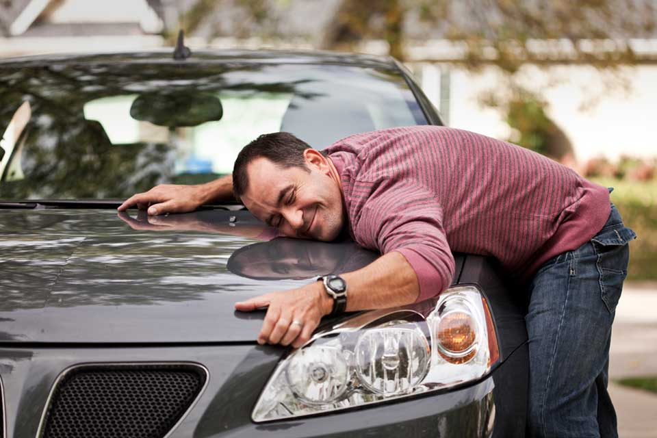 man in relationship with his car