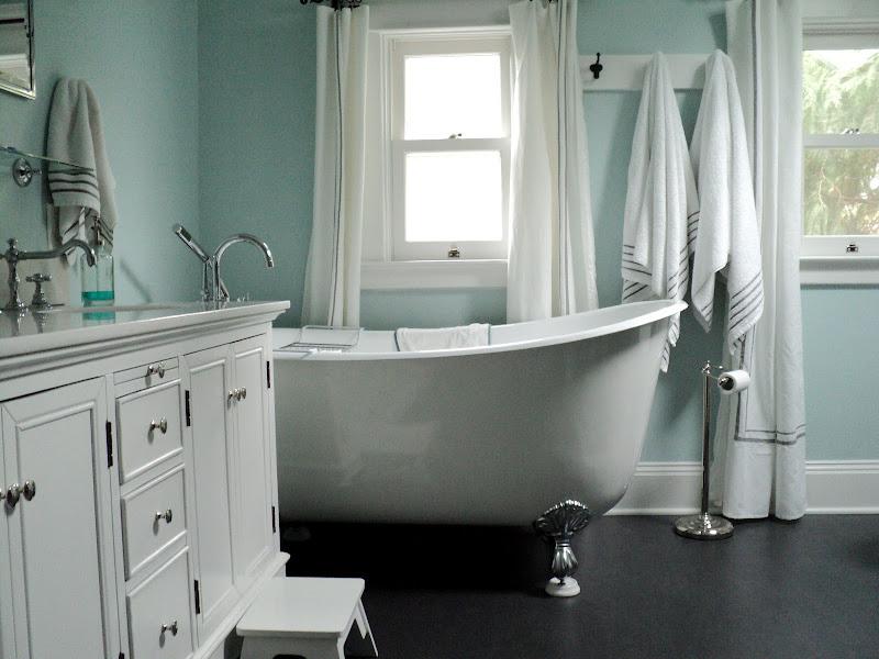 we put in a deep swedish slipper tub dark gray marmoleum flooring that  title=