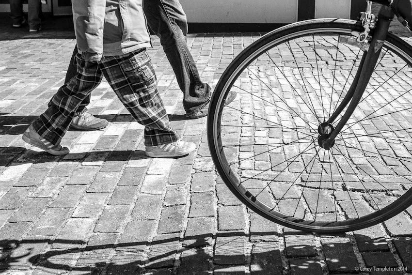 Portland, Maine bicycle spokes sidewalk wheel photo by Corey Templeton