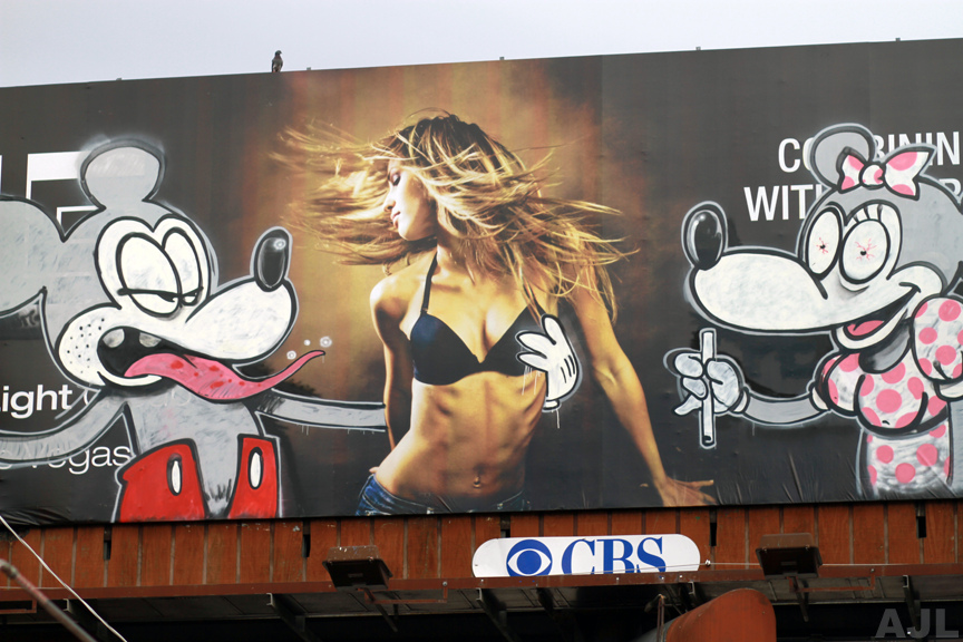 banksy street art billboard livin the dream mickey mouse