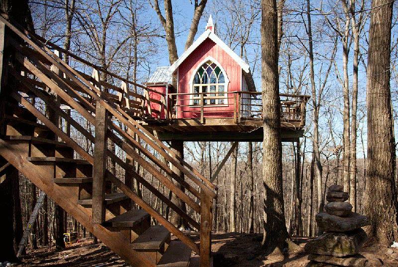the treehouse was designed to look like an old ohio barn from the 1800s painted bright red and outfitted with a 10000 gothic stained glass window