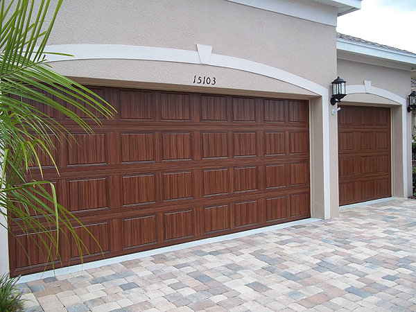 Paint your own garage door to look like wood everything for Wood look steel garage doors