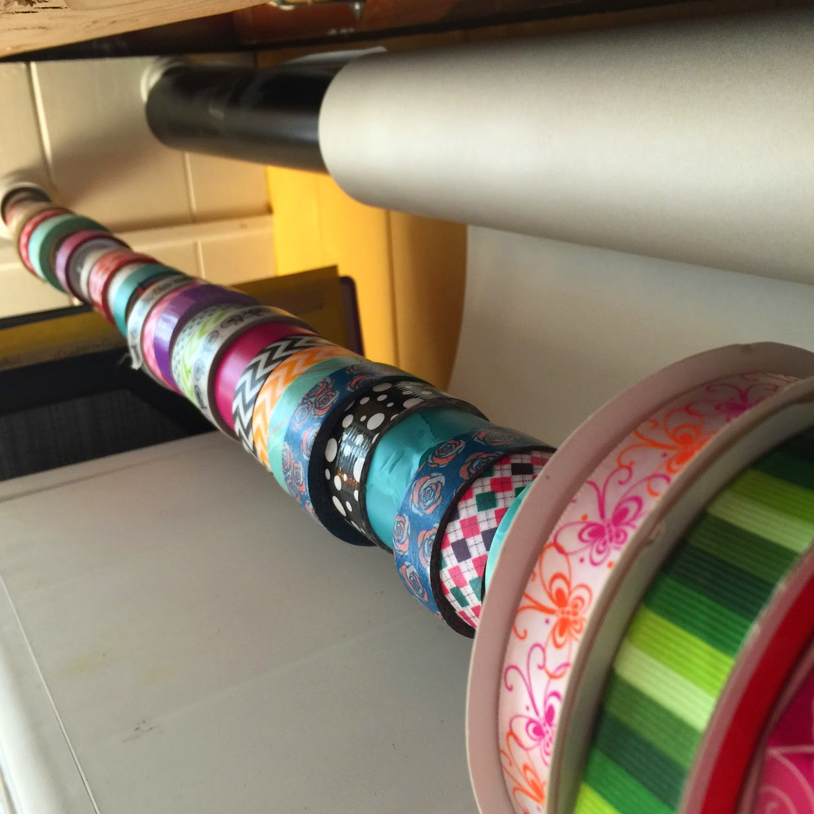 Closet rods to hold washi tape and butcher paper :: OrganizingMadeFun.com