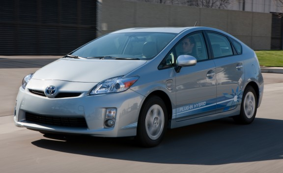 Front 3/4 view of blue 2012 Toyota Prius Plug-In Hybrid driving