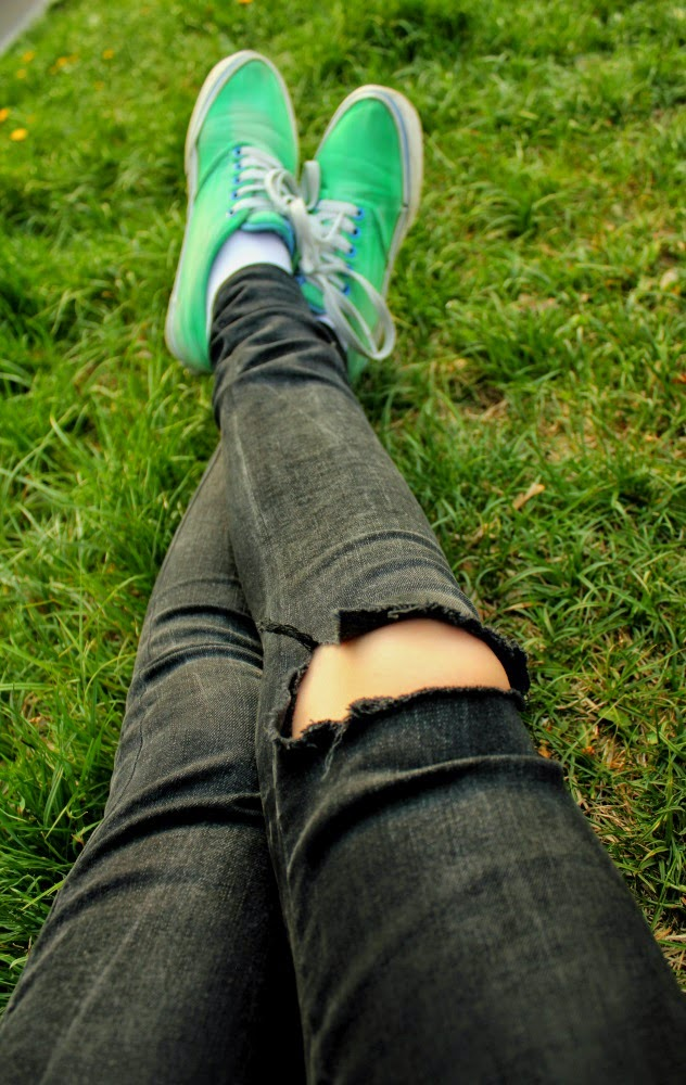 Old vans, ripped jeans and green grass