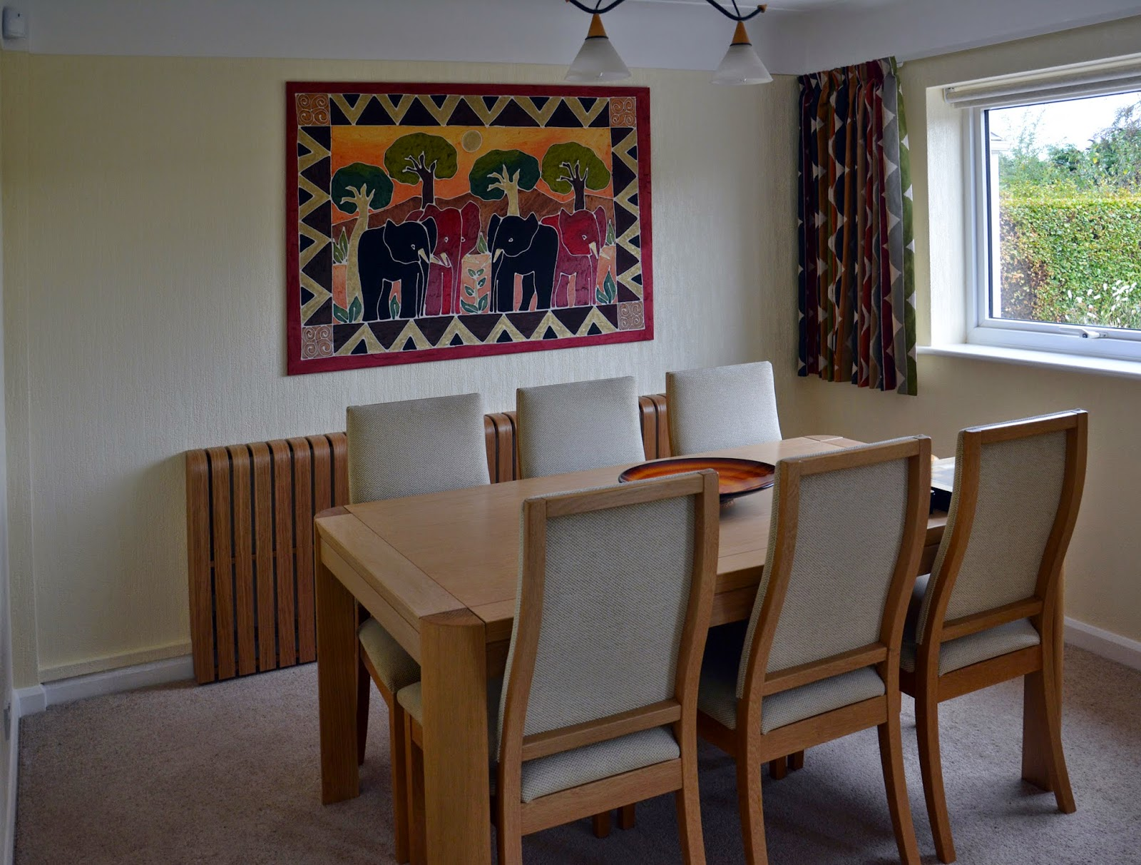 Long oak radiator cover in dinning room