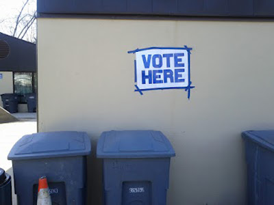 Trash cans marked 'VOTE HERE'
