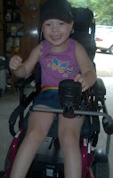 image Kaydance Lane Lindsay Ontario smiling in her Wheelchair