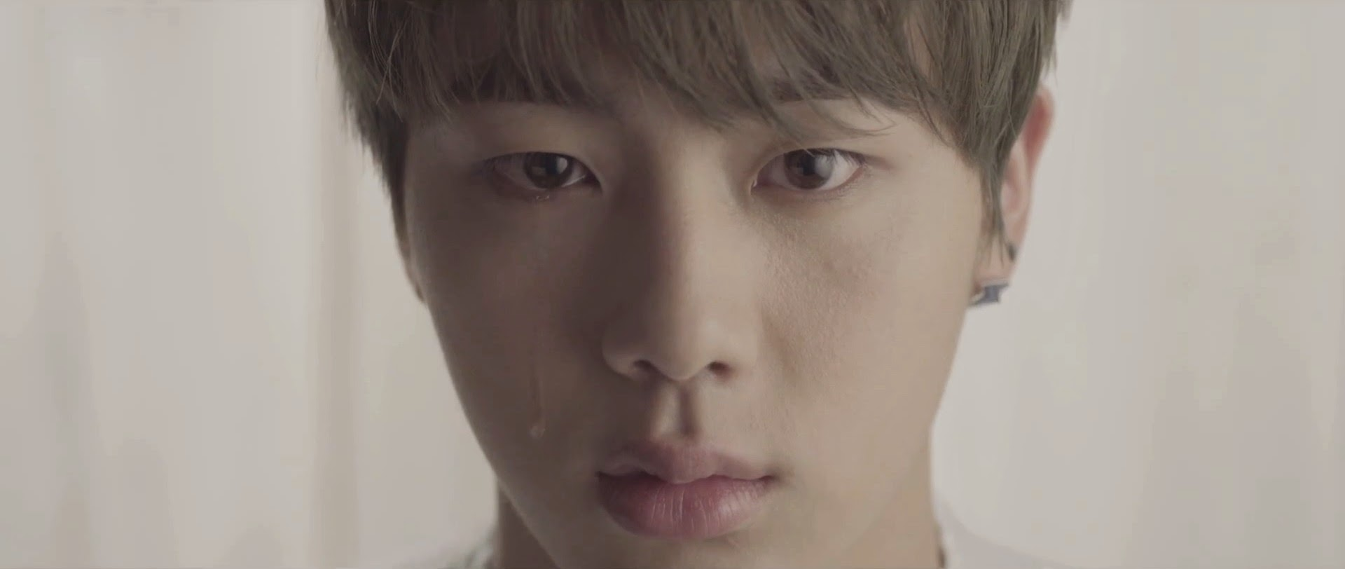Bangtan's Jin in I Need You MV