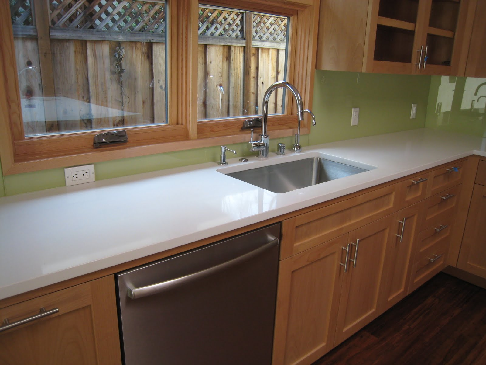 we went for a solid glass backsplash for a clean look as well as easy