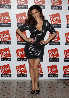 Kelly Brook strikes a pose in a short cut tight dress