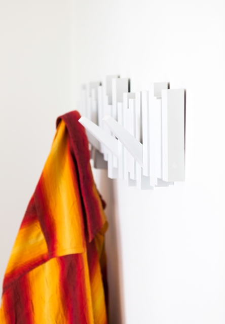 Photo of red and yellow coat hanging on the wall