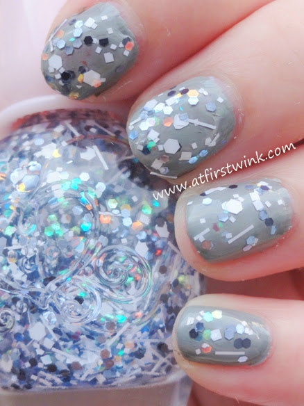 grey base color nail polish and glitters on top