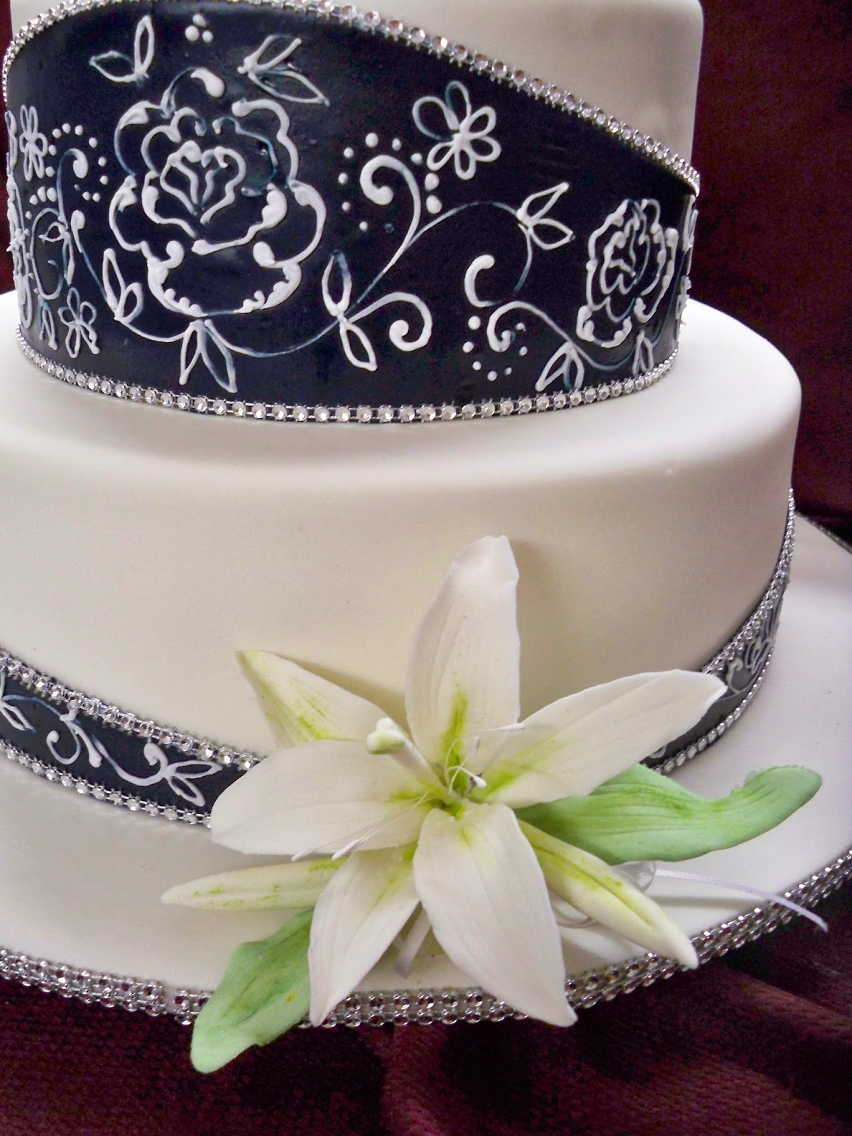 navy blue and white elegant wedding cake with oriental