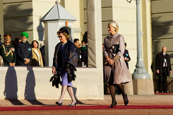 Queen Sonja of Norway (L) and Princess Mette-Marit of Norway attend the official welcoming ceremony at the Royal Palace during Day-1 of the state visit from India