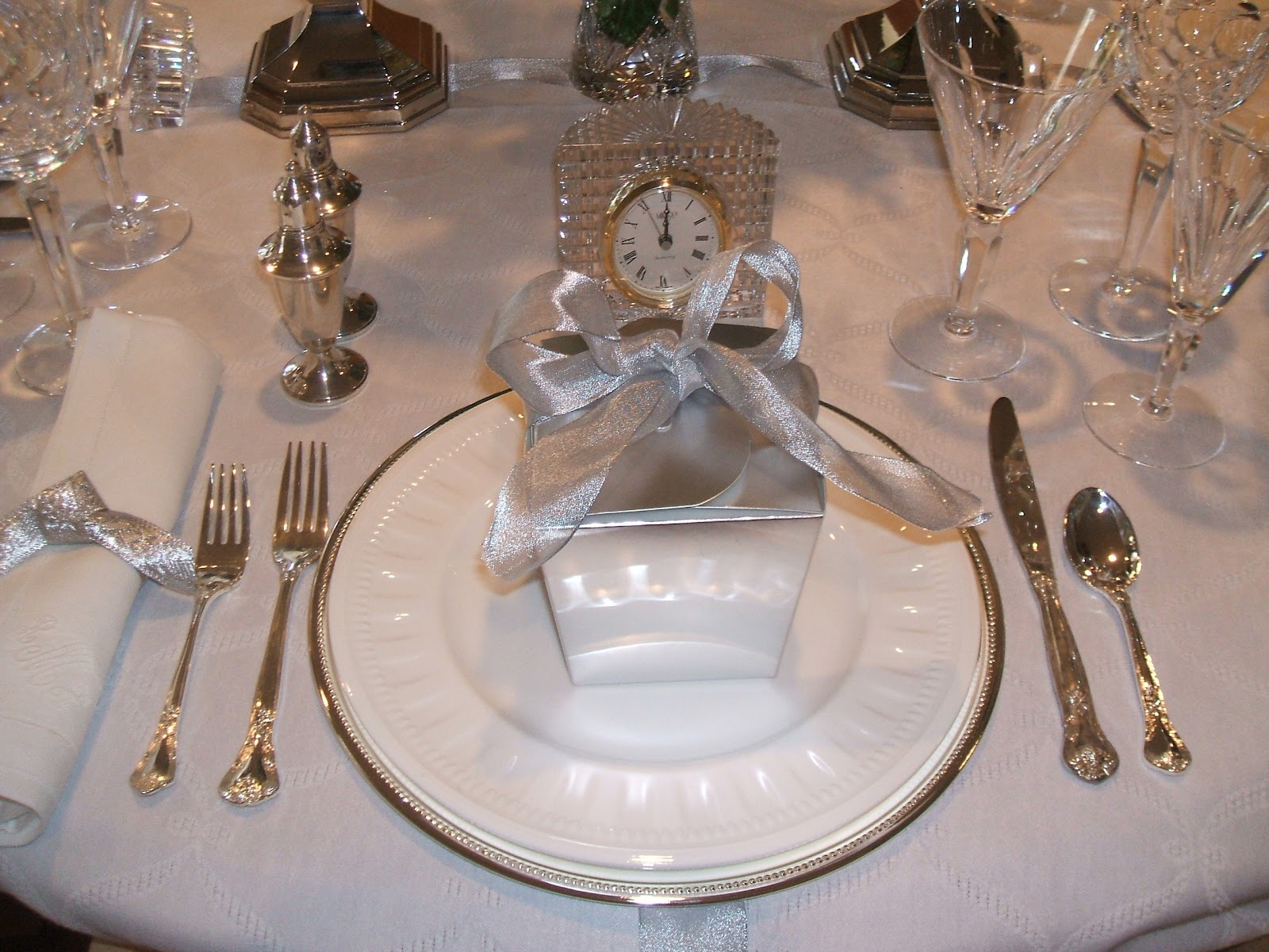 Inidual clocks were pulled from different rooms and placed at each place setting to countdown until the new year & RE-invented style: RE-ceiving Guests: New Yearu0027s Eve table
