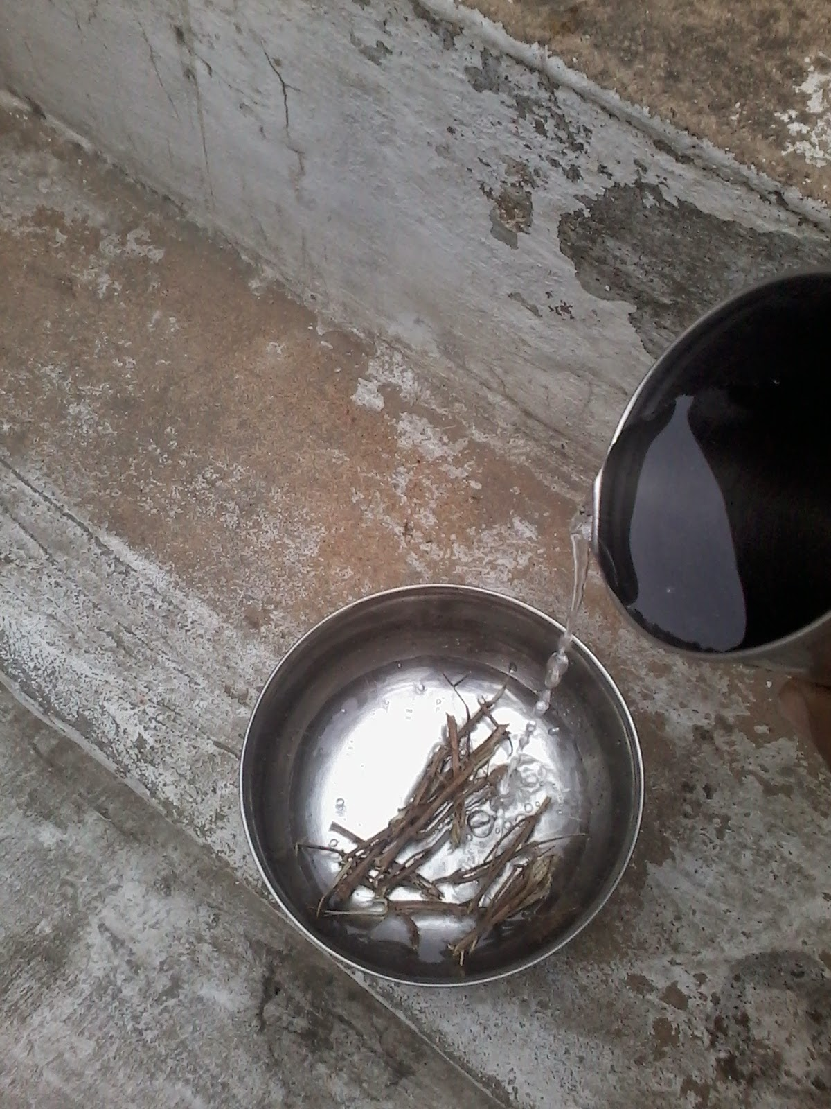 Take few pieces of dry Tulsi  in bowl and add water