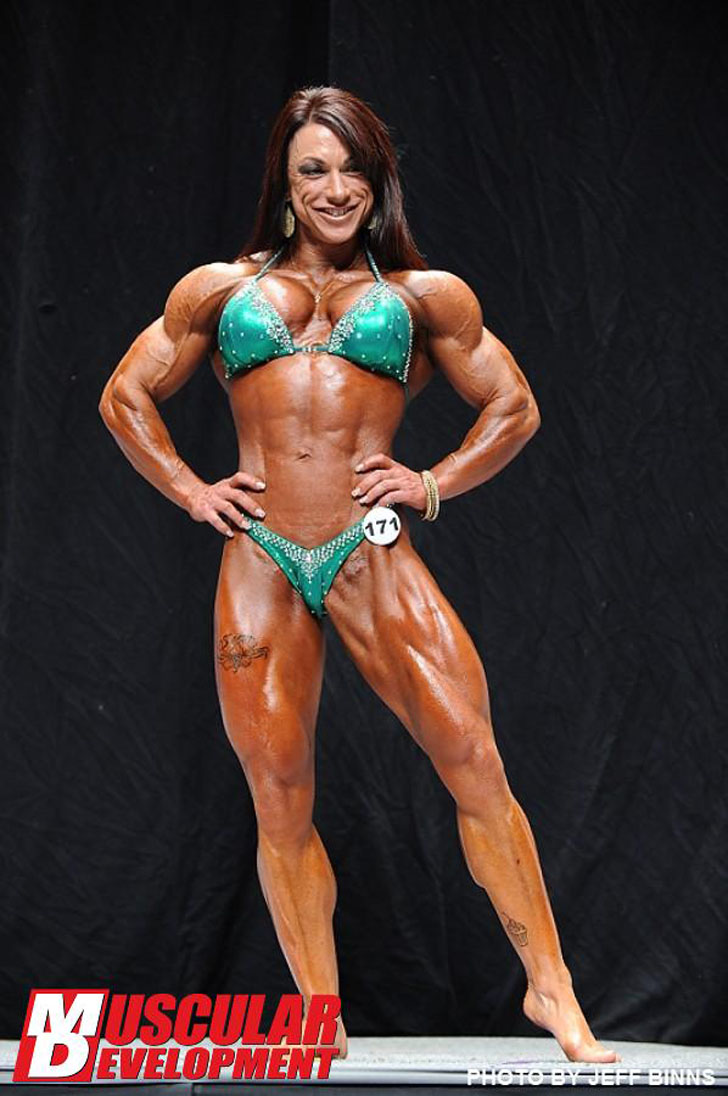 Carla Rossi Flexing Her Winning Muscles At The 2012 NPC USA