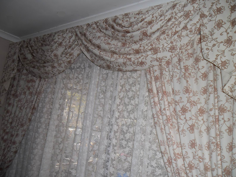 Cream/brown floral lounge curtains, swags and tails. title=