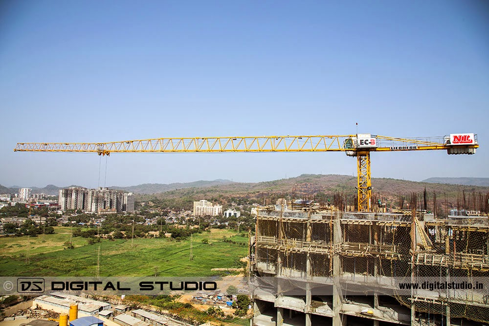 Tower crane in action on a building construction site