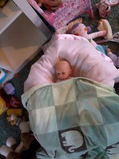 Baby doll under blanket