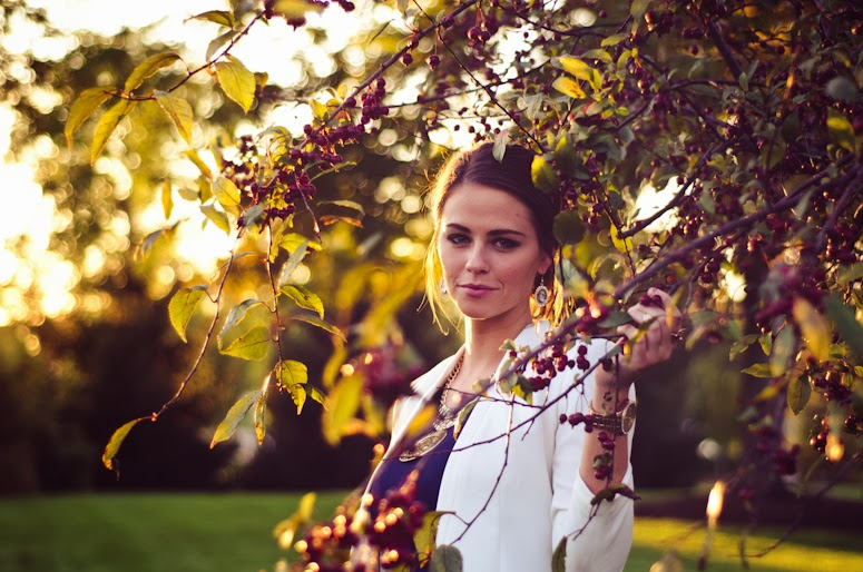 Model standing in a pretty tree.