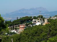 Montserrat i la urbanització de Can Nadal, des de la Serra de les Coves de Can Nadal