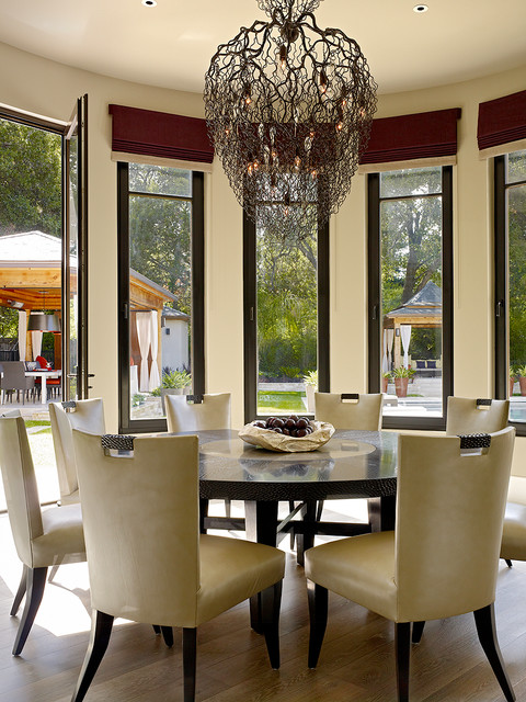 Cozy Dining Room with the Wide Unique Chandelier and Round Dining Tables on the Hardwood Floor