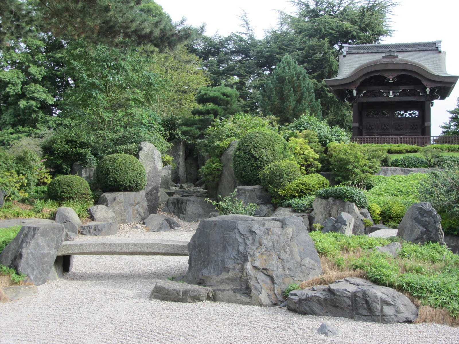 The Japanese Garden is not far from Lion Gate. It is very distinctive with  the grey rocks and gravel, neatly trimmed bushes and temple on the top of  the ...