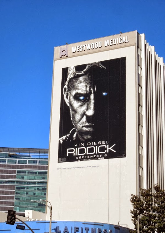 Giant Riddick movie billboard
