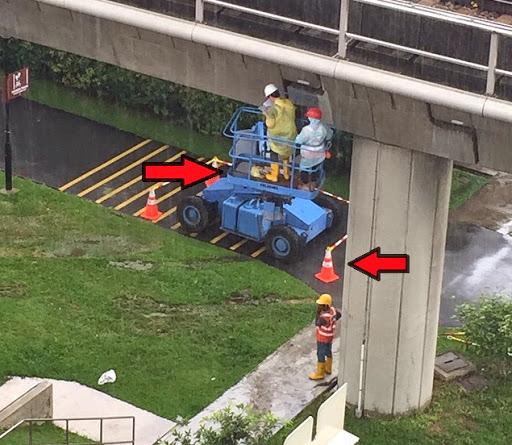 MRT singapore workers optical illusion photograph