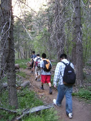 Group hiking trail into Oak Creek