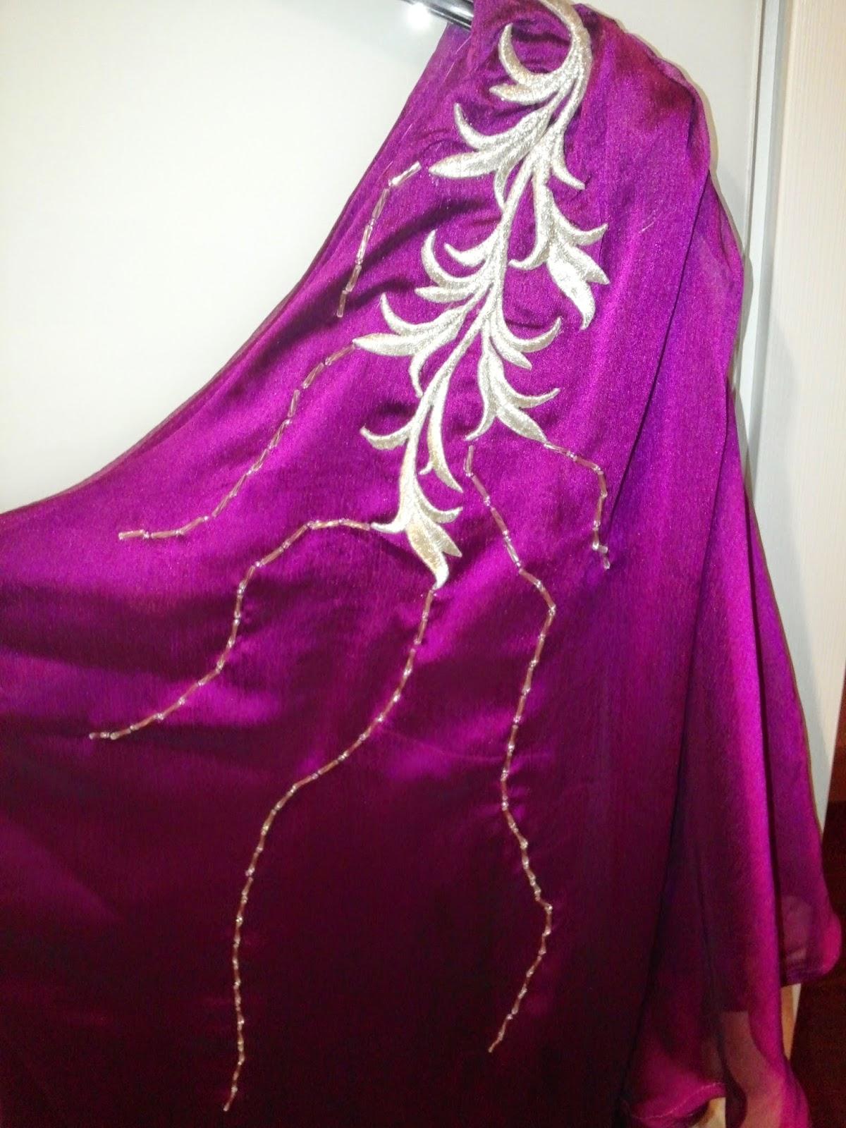 http://terzibegum.blogspot.com.tr/2014/10/tek-omuzlu-mor-elbise-burda-201401-112.html