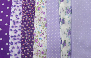 The chosen fabrics - polkadots, spots, florals in purple and lilac shades.