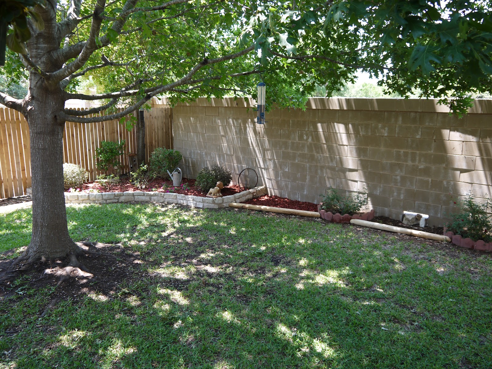 So much to dew fences and gates and landscaping oh my - Landscaping along a fence ...