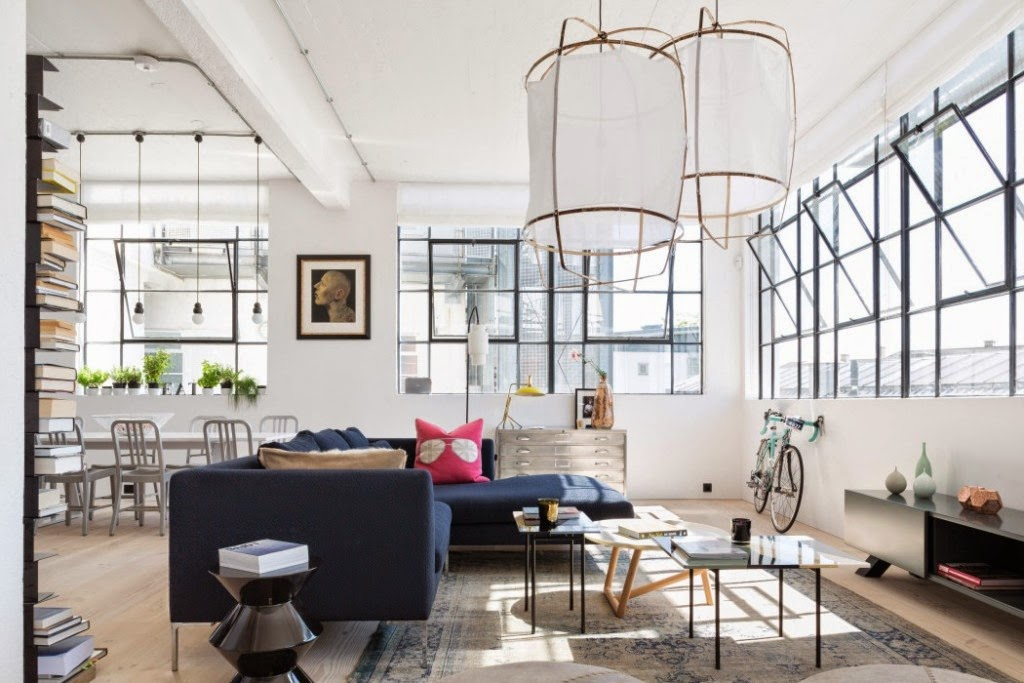 ... with its industrial interior . Black sofa , unique chandelier , as well  as an open bookcase is also a statement that is enough to attract attention  .