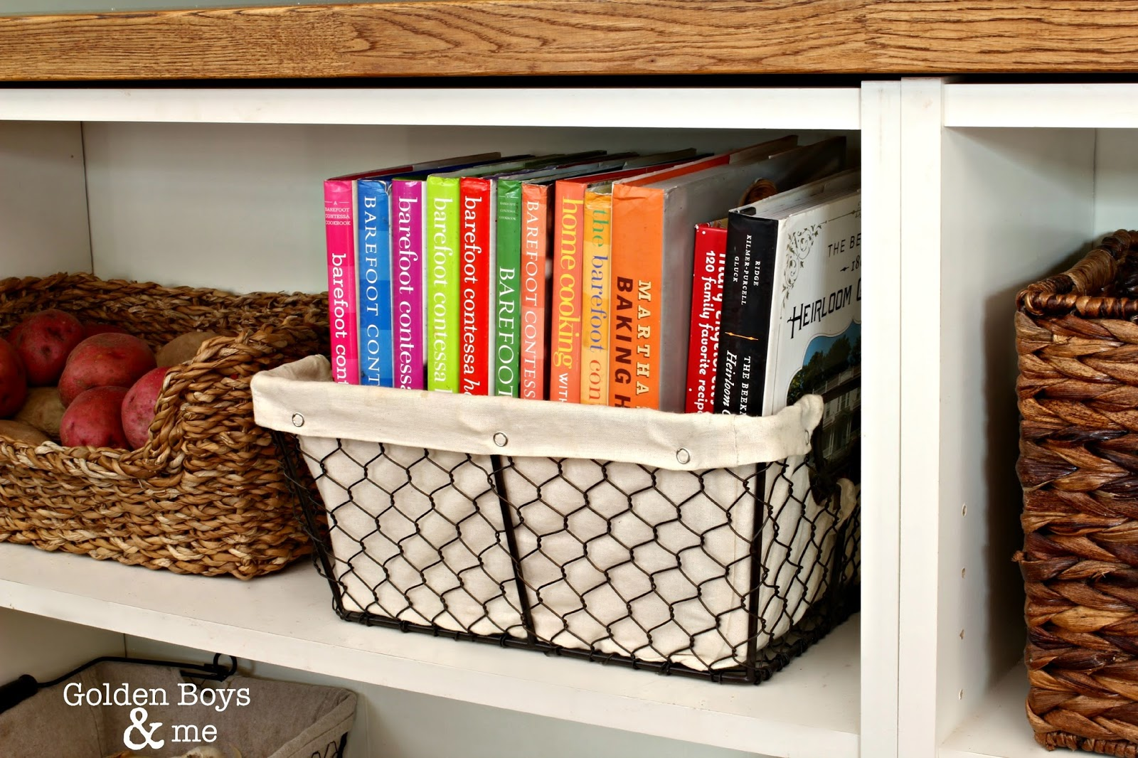 Wire basket for cookbook storage in kitchen. ll www.goldenboysandme.com