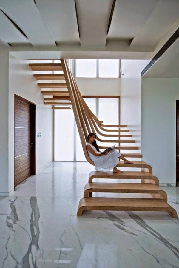 Wooden Stairs With Original Staircase Railing In Modern Interior