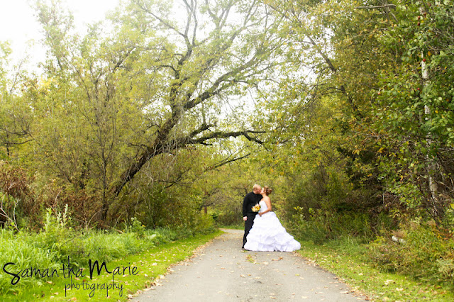 bride and groom kiss in forest