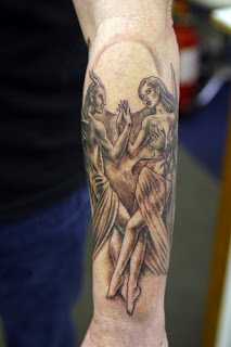 Satan / angel of death tattoo on the arm