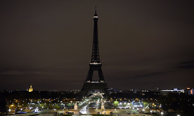 Eiffel Tower shuts off its lights as the City of Paris mourns for the loss the killed people