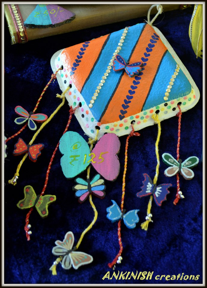 Ankinish creations butterfly wall hanging for Best out of waste wall hanging