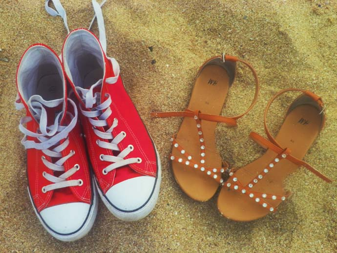 Flat sandals from H&M and red sneakers from New Yorker on the beach in Sozopol, Bulgaria