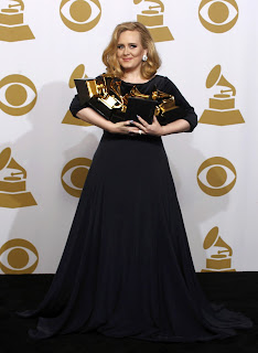 Adele with an armfull of Grammys