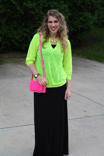 black maxi dress, neon yellow sweater, pink crossbody Kate Spade bag