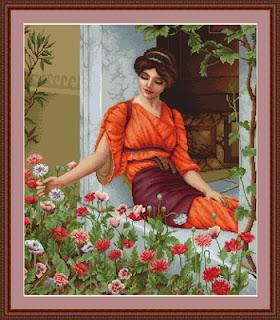 kit de punto de cruz de la marca Lucas con motivo de una mujer tocando flores de jardin