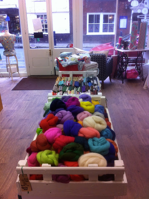 a rainbow of coloured wools used for feltmaking