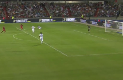 Luxembourg player Daniel da Mota shoots to score the opening goal against Portugal